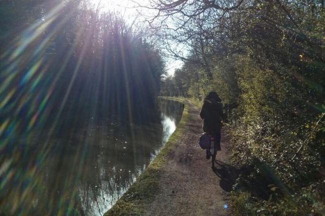Robyn cycling along the towpath
