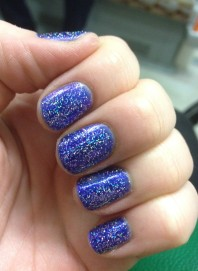 Sparkly blue nails are nice